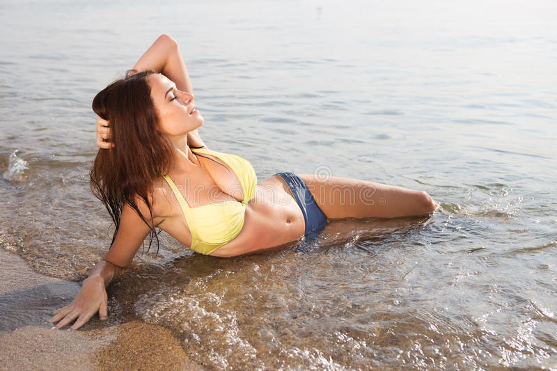 Young woman in a swimsuit in the sea water royalty free stock photos