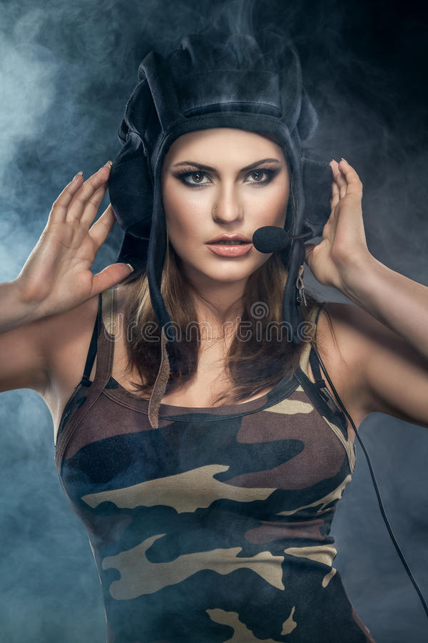 Young woman. Wearing helmet with microphone. military style royalty free stock photos