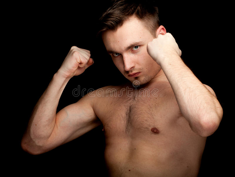 Download Young Shirtless Man Ready To Fight Stock Photo - Image of furious, adult: 19267358