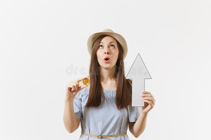 Young shocked sad woman holding bitcoin, coin of golden color, down value fall arrow isolated on white background stock photos