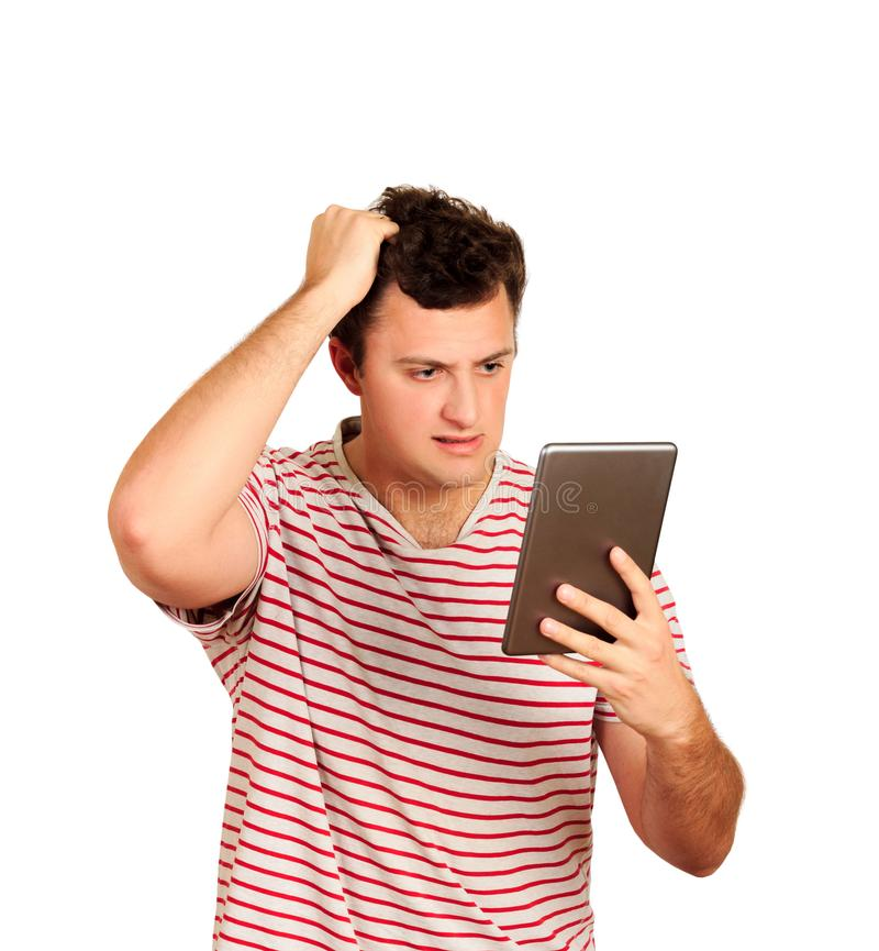 Young shocked student working on a digital tablet. emotional guy isolated on white background stock image