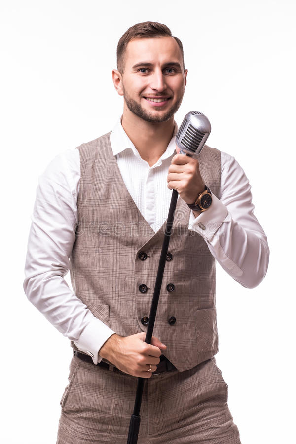 Young showman in suit singing with emotions and pointed gesture over the microphone with energy royalty free stock photography