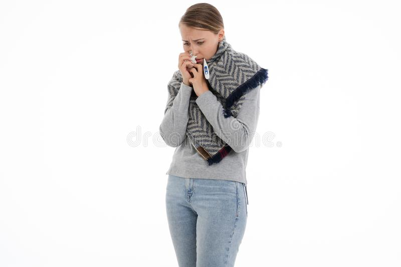 Young sick woman wrapped in a scarf. Cold, flu, illness. Young sick woman wrapped in a scarf on white background. Cold, flu, illness royalty free stock photos