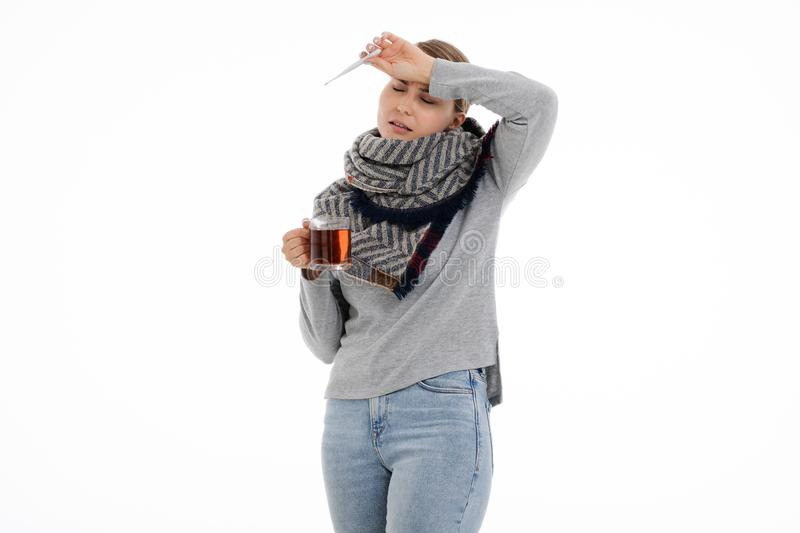 Young sick woman wrapped in a scarf. Cold, flu, illness. Young sick woman wrapped in a scarf on white background. Cold, flu, illness stock photos