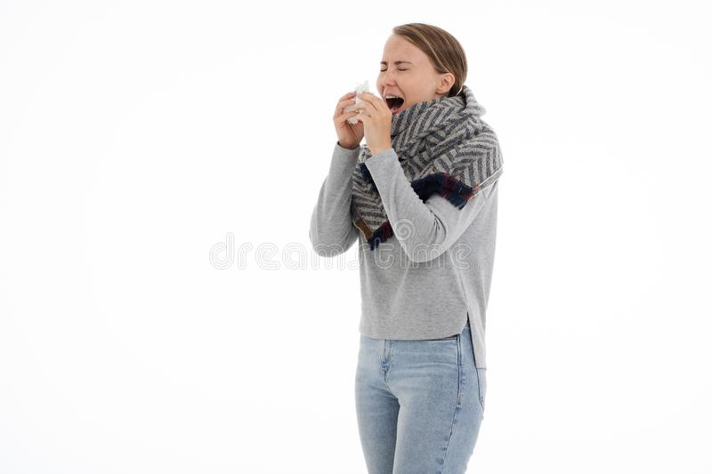 Young sick woman wrapped in a scarf. Cold, flu, illness. Young sick woman wrapped in a scarf on white background. Cold, flu, illness stock images