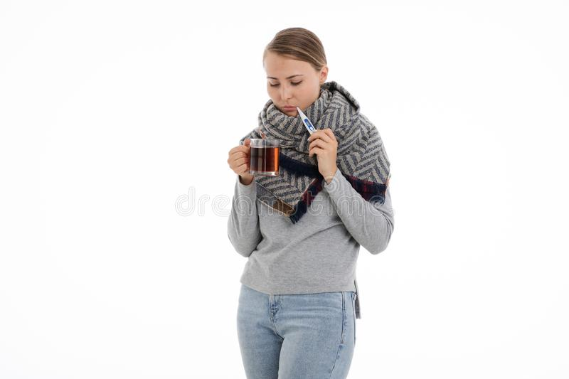 Young sick woman wrapped in a scarf. Cold, flu, illness. Young sick woman wrapped in a scarf on white background. Cold, flu, illness royalty free stock photo