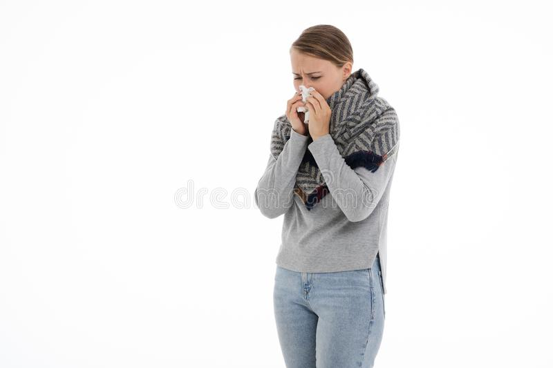 Young sick woman wrapped in a scarf. Cold, flu, illness. Young sick woman wrapped in a scarf on white background. Cold, flu, illness stock photography