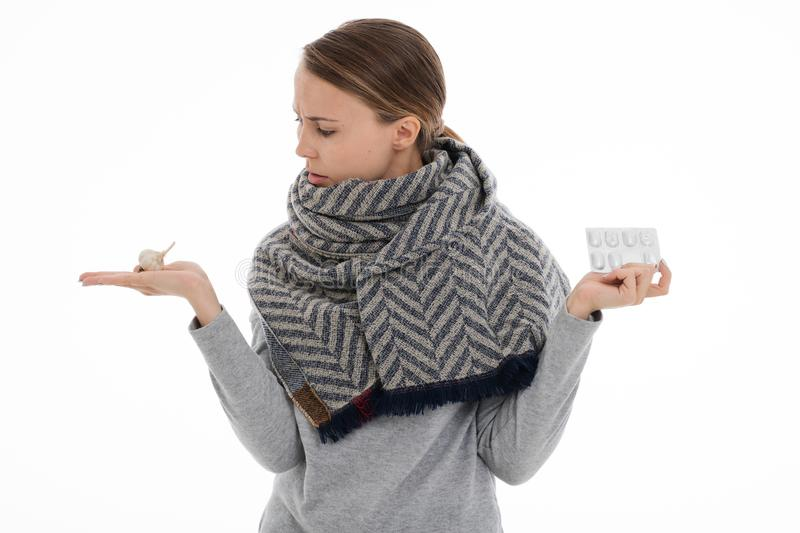 Young sick woman wrapped in a scarf. Cold, flu, illness. Young sick woman wrapped in a scarf on white background. Cold, flu, illness stock image