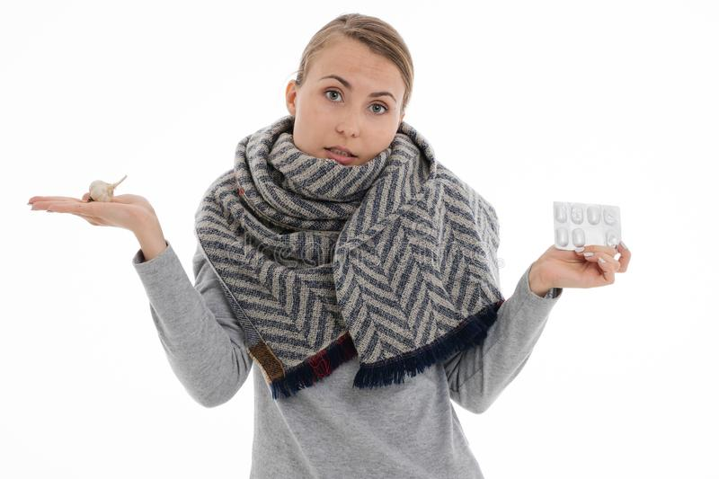 Young sick woman wrapped in a scarf. Cold, flu, illness. Young sick woman wrapped in a scarf on white background. Cold, flu, illness royalty free stock photography