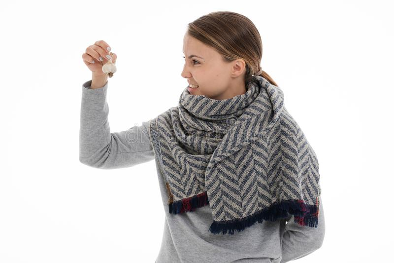 Young sick woman wrapped in a scarf. Cold, flu, illness. Young sick woman wrapped in a scarf on white background. Cold, flu, illness royalty free stock images