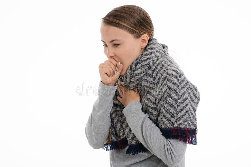 Young sick woman wrapped in a scarf. Cold, flu, illness stock photography