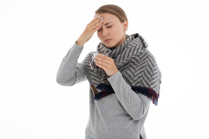 Young sick woman wrapped in a scarf. Cold, flu, illness. Young sick woman wrapped in a scarf on white background. Cold, flu, illness stock photo
