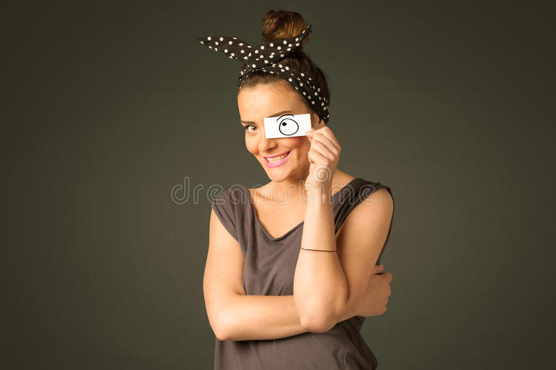 Young silly girl looking with hand drawn eye balls on paper. Concept royalty free stock image