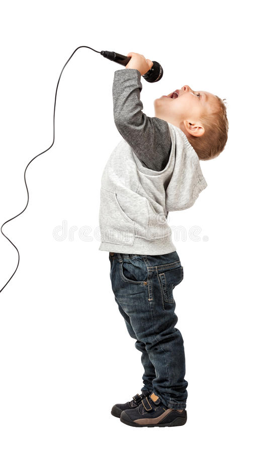 Young singer. Child sing and enjoy with microphone isolate don white background royalty free stock photo