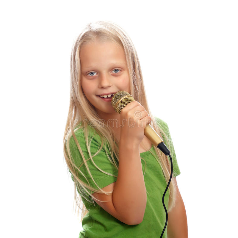 Young singer. A young female singer with a golden microphone stock photo