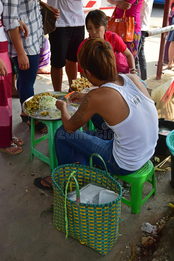 Young single roadside vendor preparing & selling local favorite snacks outside of Bogyoke Market at Yangon, Myanmar stock photos
