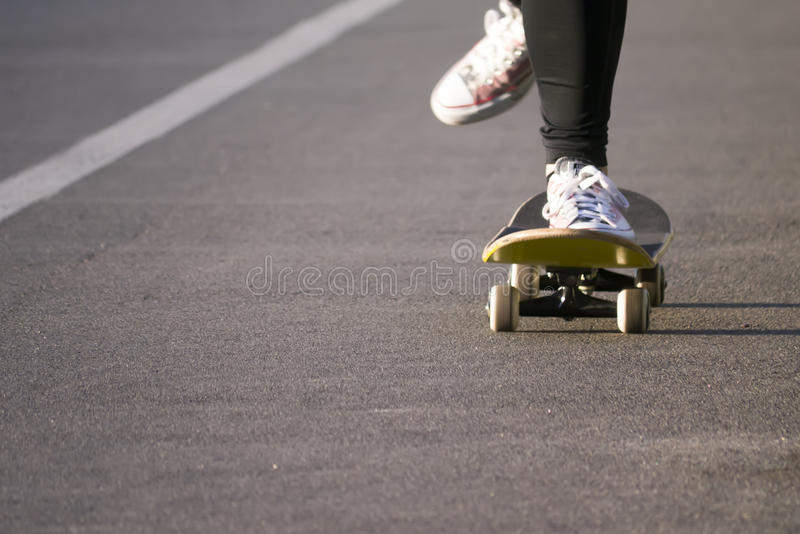 Young skateboarder legs riding skateboard royalty free stock images