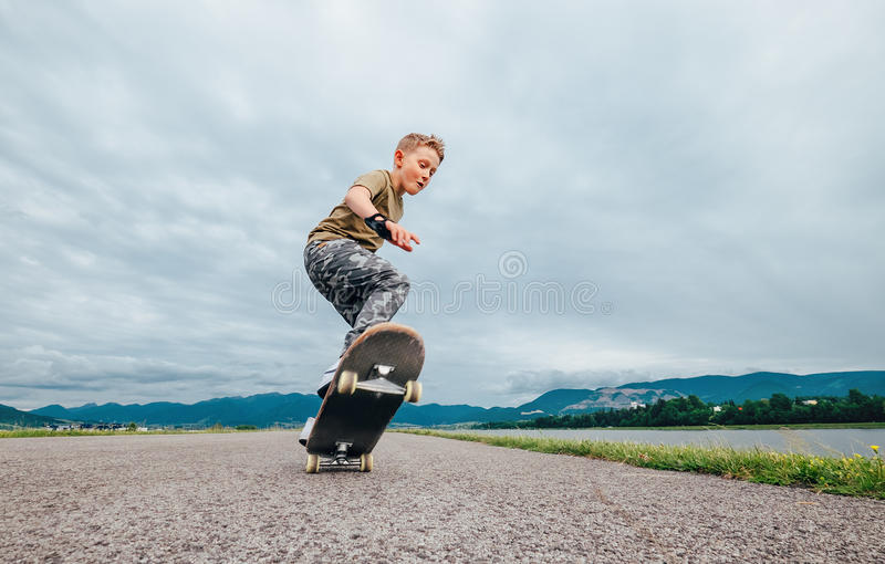 Young skateboarder make a tricks with skateboard royalty free stock image