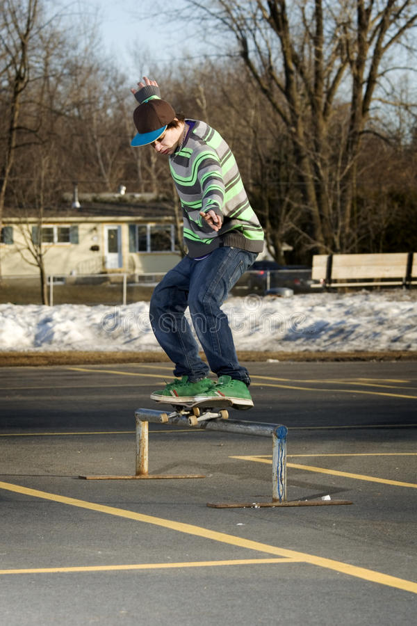 Young skateboarder performing a 50-50 grind stock image