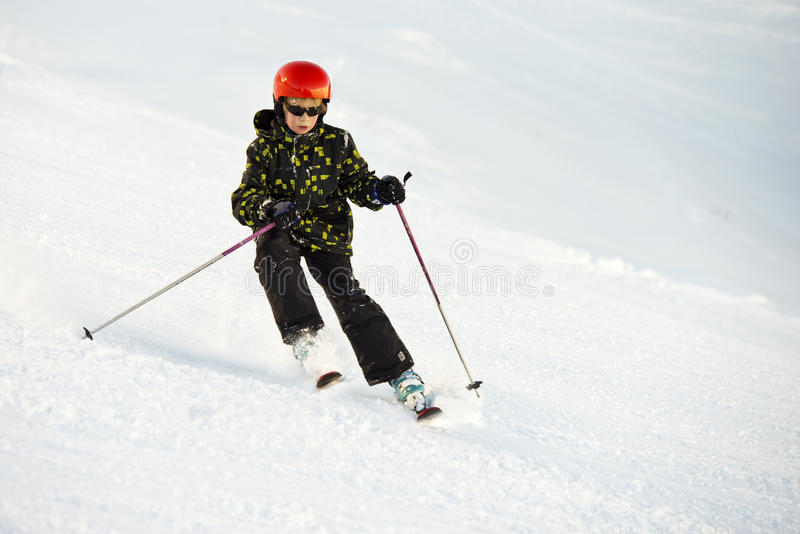 Young skier during a decent stock photos