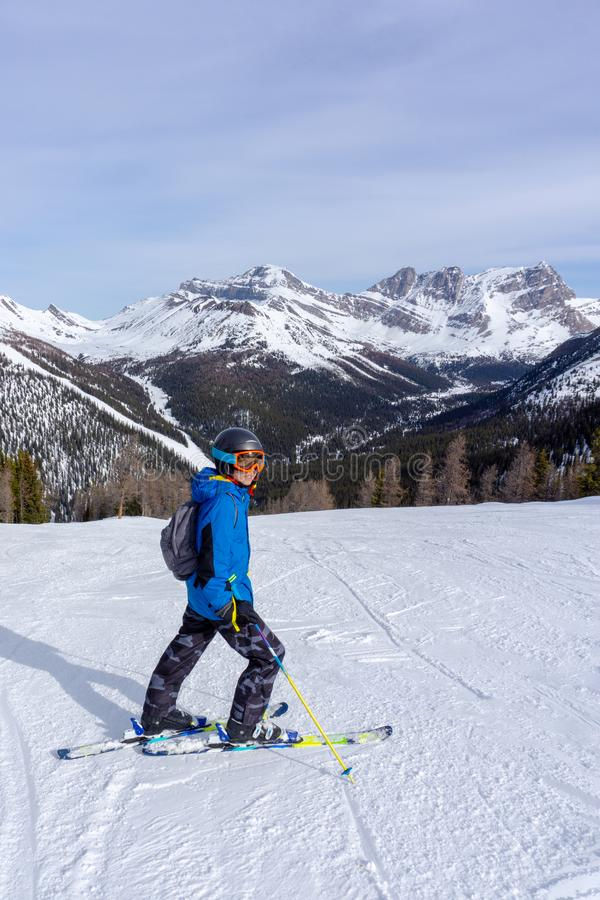 Young Skier on top of  Mountain at Lake Louise in the Canadian Rockies. Young skier at the top of a mountain range in Lake Louise in the Canadian Rockies of royalty free stock image