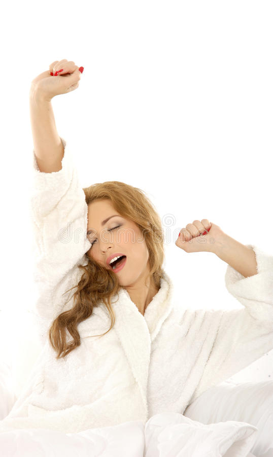 A young and sleepy Caucasian woman stretching royalty free stock photography