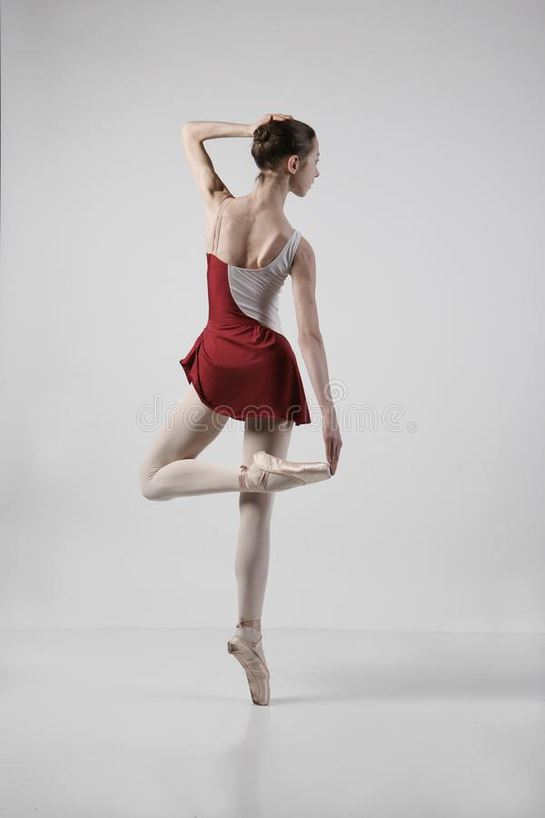 Ballerina in a red suit stock photography