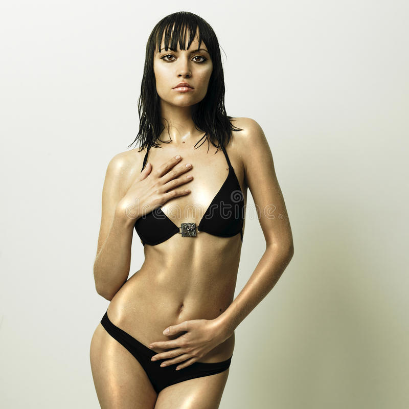 Young Slender Woman In Fashionable Swimsuit Stock Photo