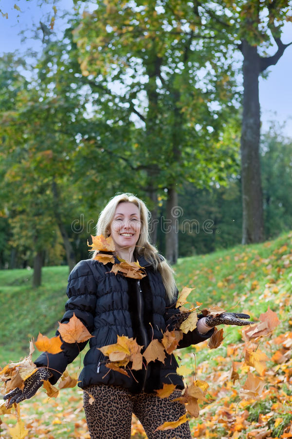 The young slender woman in park royalty free stock image