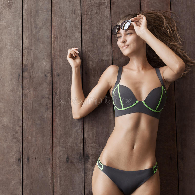 Young slim beautiful woman in bikini. royalty free stock images