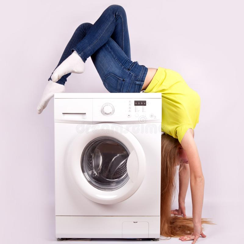 Washing machine and beautiful woman isolated on white background. Appliances royalty free stock photo