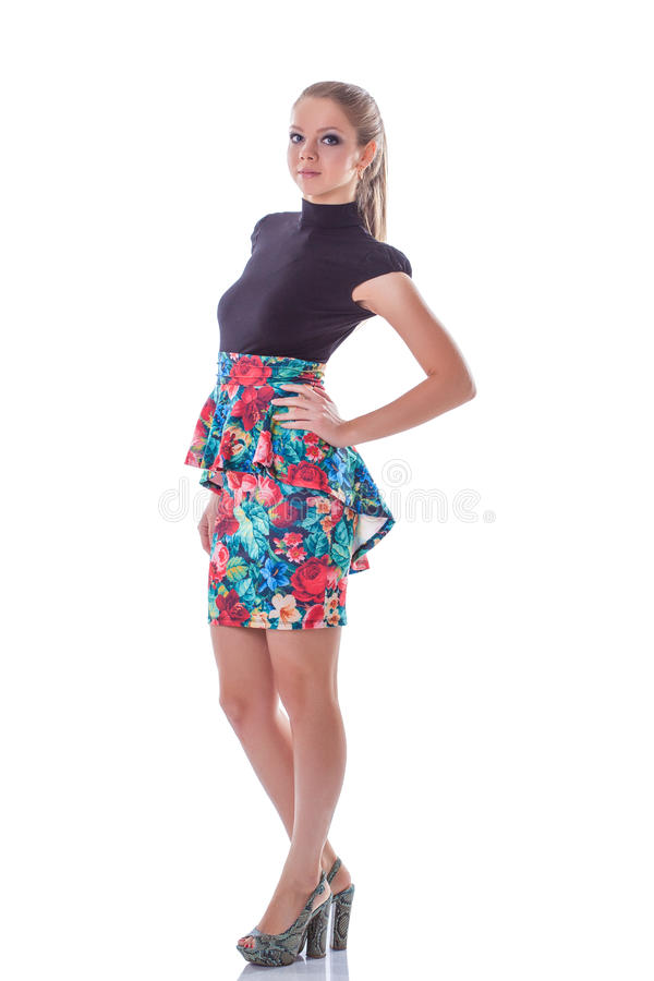 Young slim girl posing in stylish colorful dress royalty free stock photos
