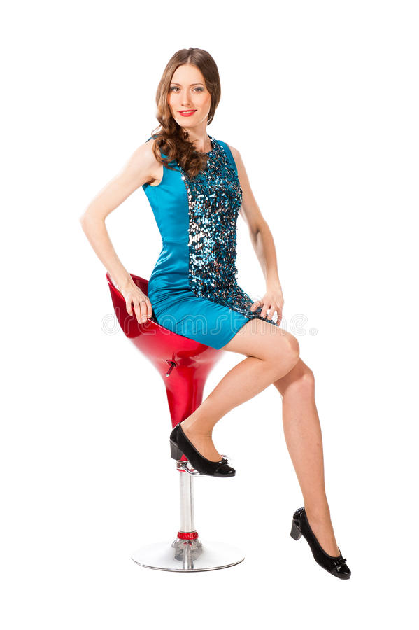Young slim pretty woman in blue dress posing royalty free stock photography