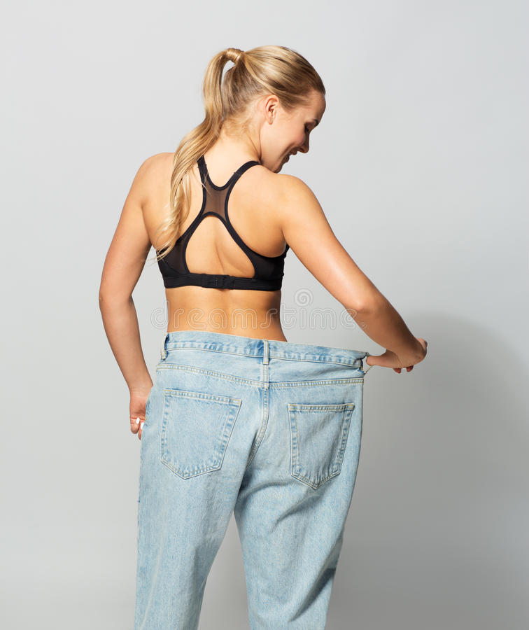 Young slim sporty woman in oversize pants royalty free stock photo