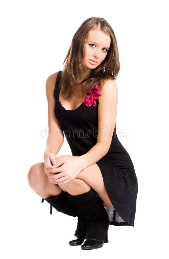 Young slim woman in elegant sitting pose stock photo