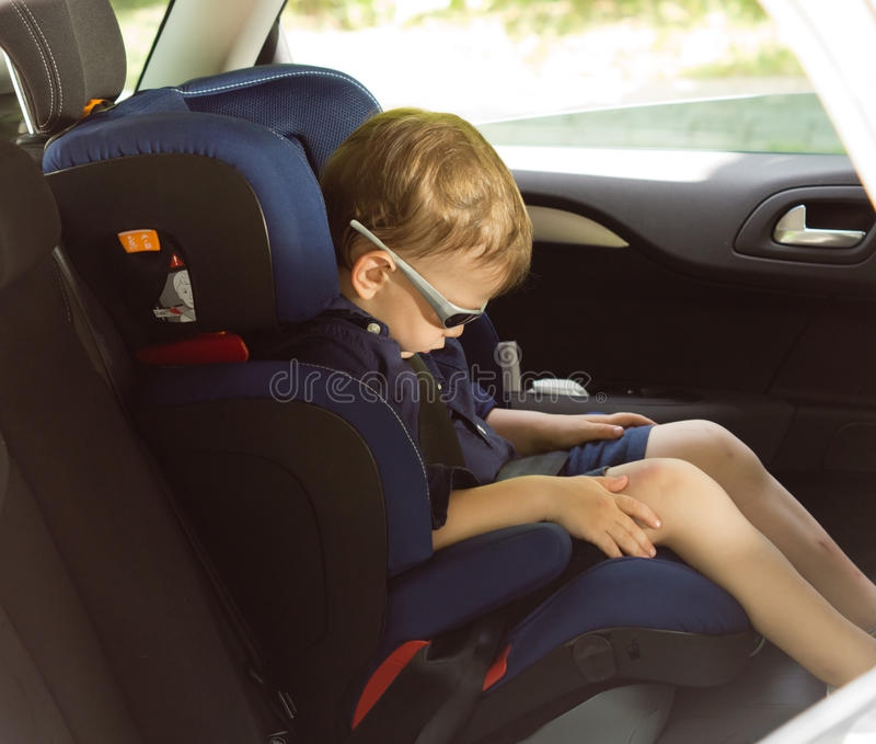 Download Young Small Boy Sleeping In A Child Car-seat Stock Image - Image: 31333891