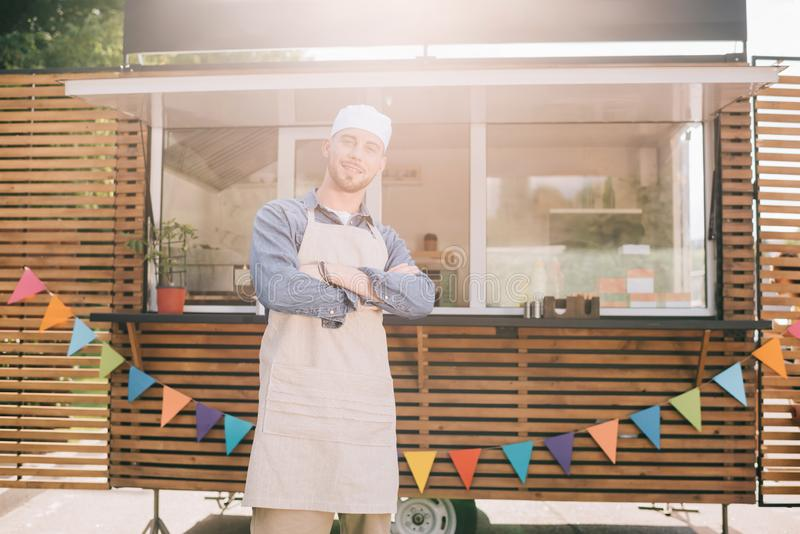 young small business owner standing with crossed arms and smiling at camera stock photos