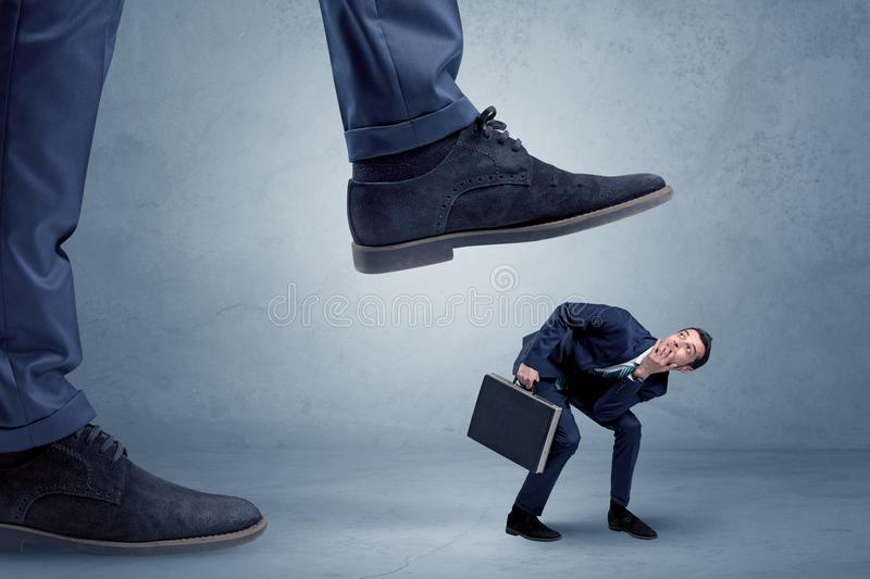 Download Trampled Small Businessman In Suit Stock Photo - Image of domination, overbearing: 110959310