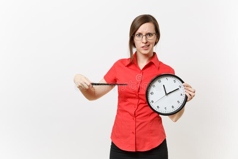 Young smart business teacher woman in red shirt glasses holding round clock, wooden classroom pointer on copy space stock images
