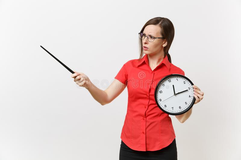 Young smart business teacher woman in red shirt glasses holding round clock, wooden classroom pointer on copy space royalty free stock photography