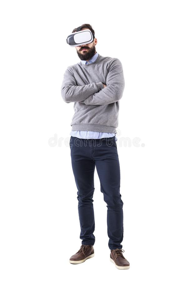 Young smart casual man wearing vr glasses with crossed arms. stock photography