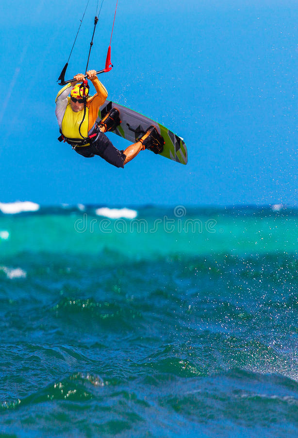 Young smiing kitesurfer on sea background Extreme Sport Kitesur. Young smiing kitesurfer on tropical sea background Extreme Sport Kitesurfing stock images