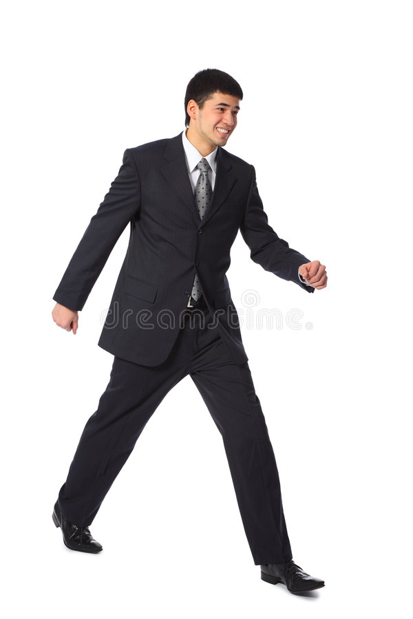 Young smiling asian businessman full body walks stock image