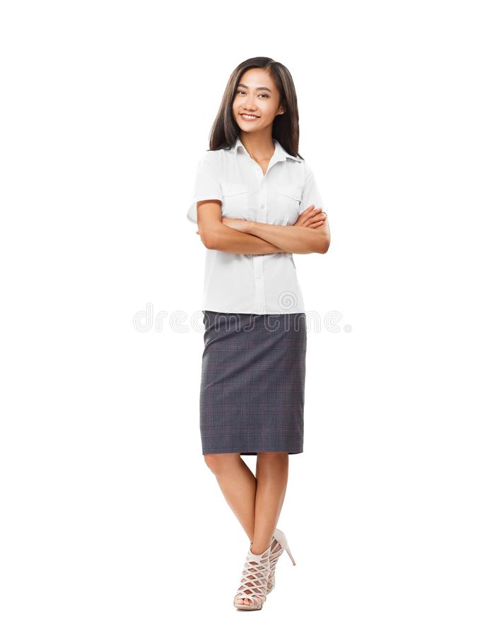 Young smiling Asian woman in full length with crossed arms stock photography
