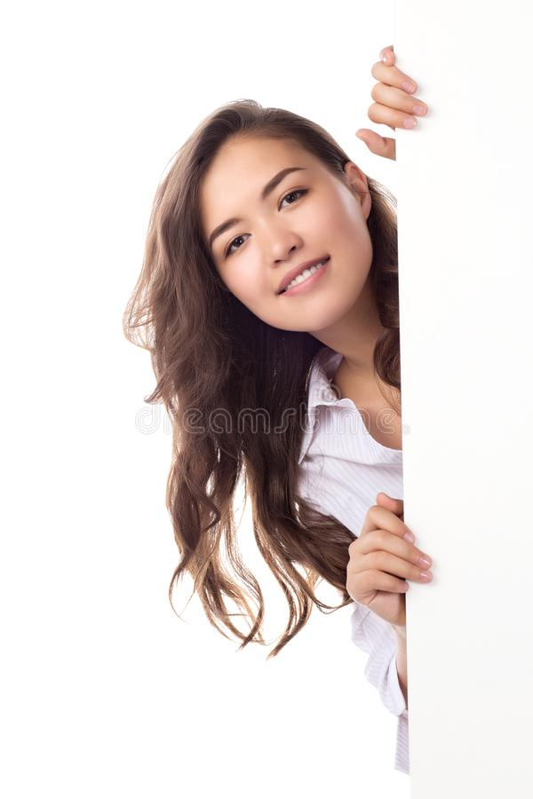 Young smiling asian woman showing blank white placard. stock images