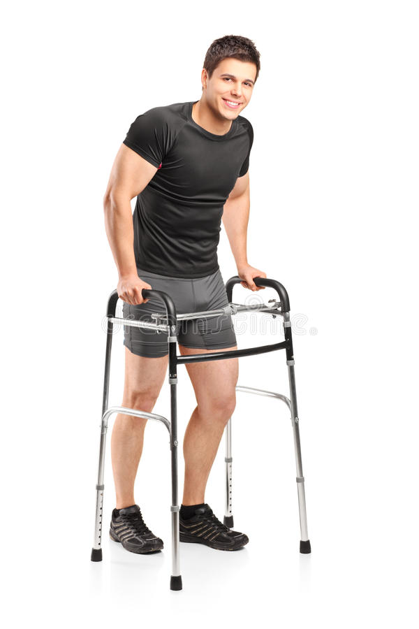 Young smiling athlete using a walker royalty free stock images