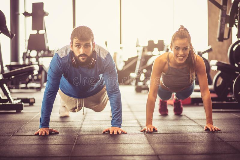 Push-ups. Couple working exercise. stock images