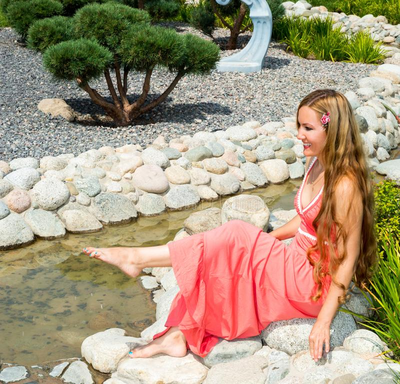 Young smiling beautiful woman with long hair outdoor portrait. stock photos