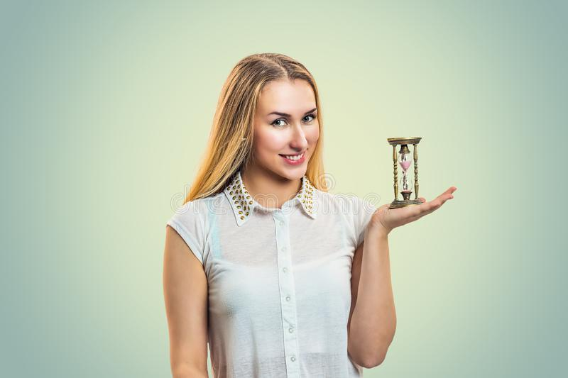 Casual woman holding hourglass stock photos