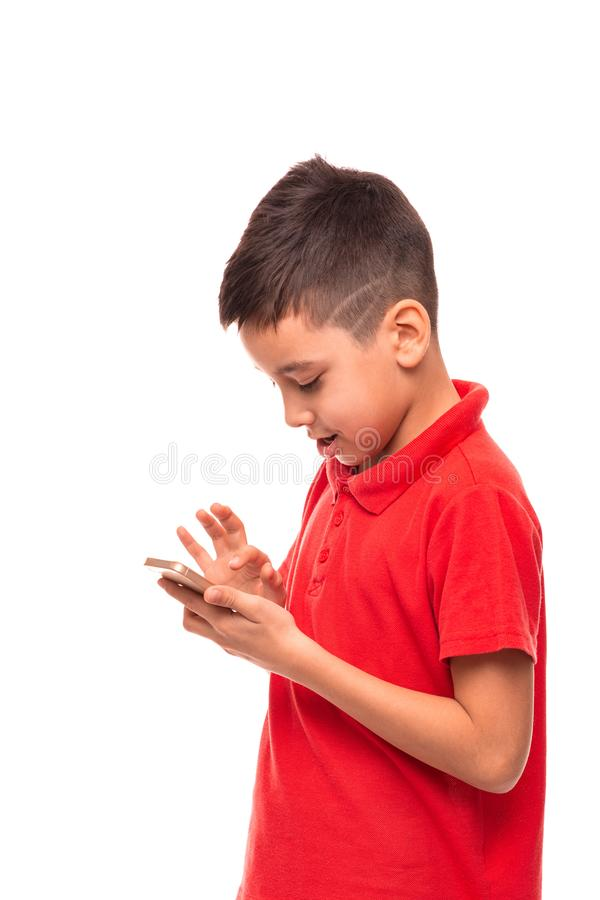 A young smiling boy  writes sms on his mobile royalty free stock images